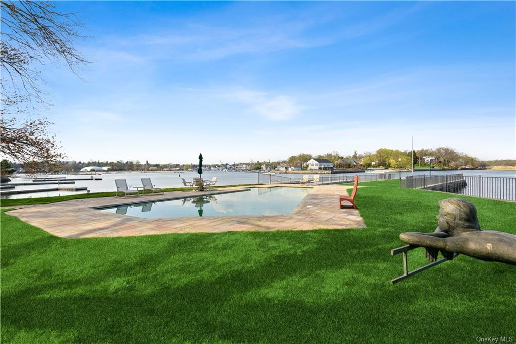 Picture your summer here.  Pool, beach, yard, views.  Live the waterfront dream without the traffic.
