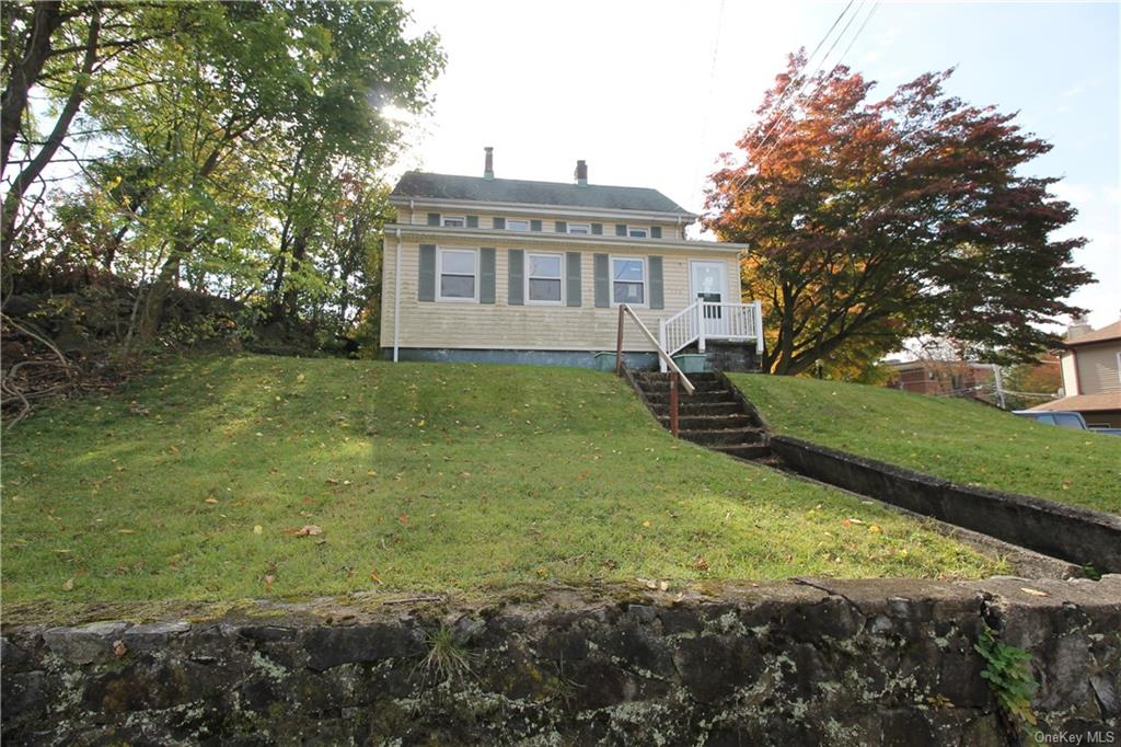 EXCELLENT INCOME PRODUCTING OPPORTUNITY - 2 Family home on a lovely lot with great curb appeal right