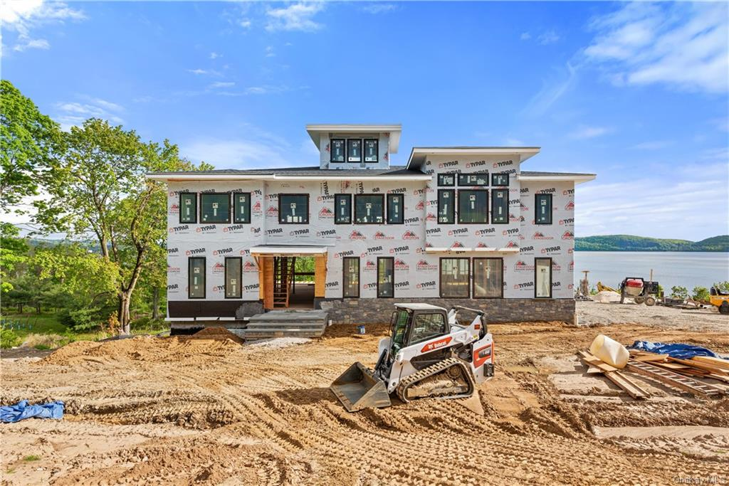 Jaw-dropping panoramic Hudson River views from this magnificent custom Colonial. Brilliantly designe