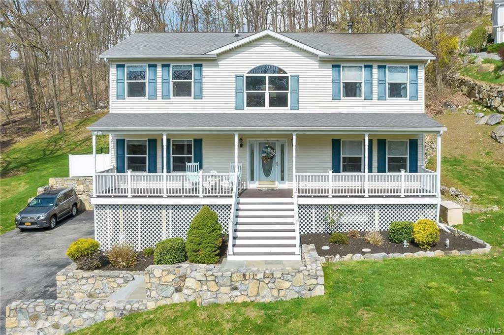 Enjoy the best Hudson Valley Lifestyle in this amazing home located at the end of a cul de sac. Step into this home & be dazzled with the light that fills this home. On the main level there is an open concept EIK, family room w/sliders out to the partially fenced in yard & deck. The family room is warm & cozy with a fireplace for chilly winter evenings. Also on this floor, you have a formal dining & living room.  Upstairs you will find hallway with a washer & dryer, and hall bath with double sinks. The primary bedroom has an updated spa bathroom. In the basement exercise room, storage & 2 car garage. Hardwood floors as seen. This home is located in Continental Village, where you can join their Lake Association to enjoy swimming & community