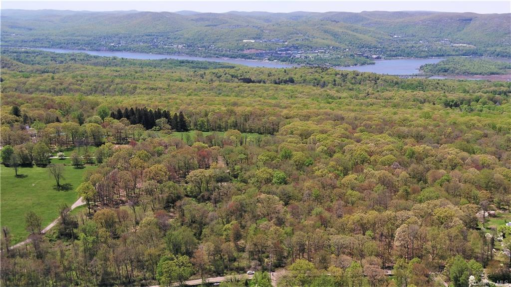 A rare and unique opportunity to purchase approximately 22 lightly wooded level acres with distant m
