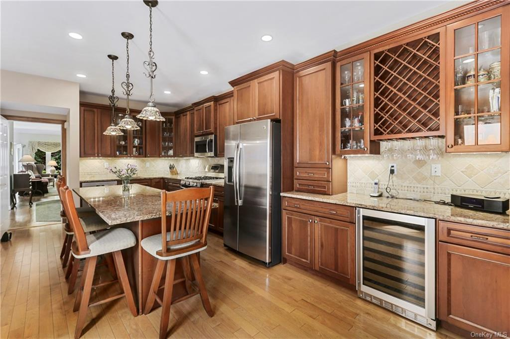 Completely renovated home offers a modern kitchen with breakfast bar, built in entertainer's area wi