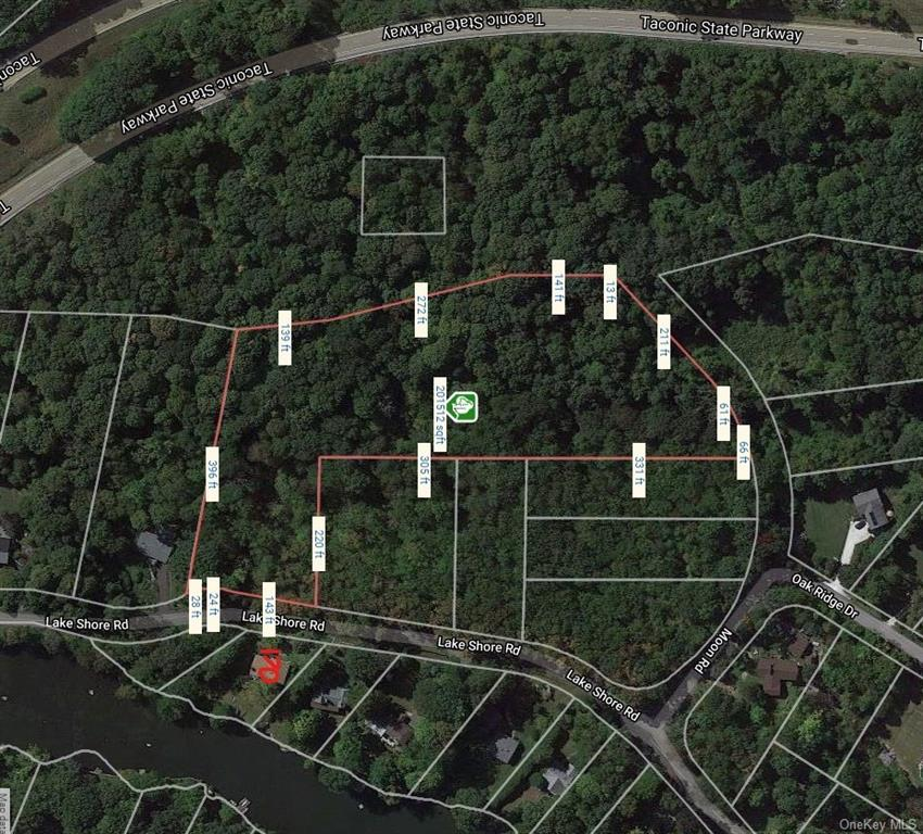4.61 Acres in Roaring Brook in Putnam Valley. 192 Ft of road frontage. L shaped property runs behind