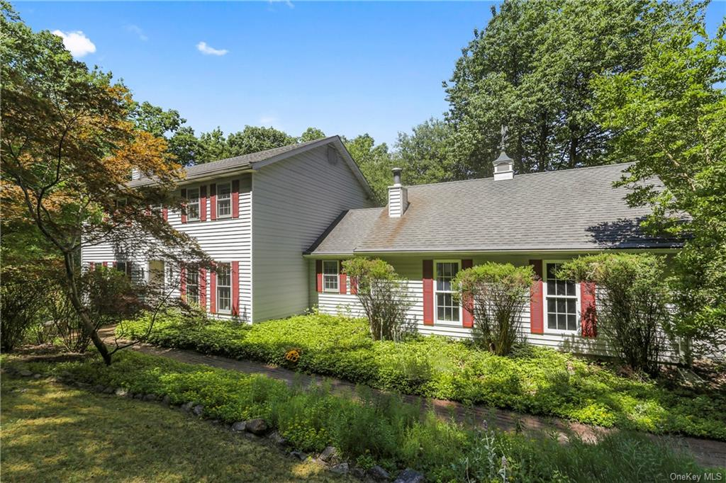 Nature will captivate you in this Wonderful Classic Colonial nestled in a lush private setting. Loca