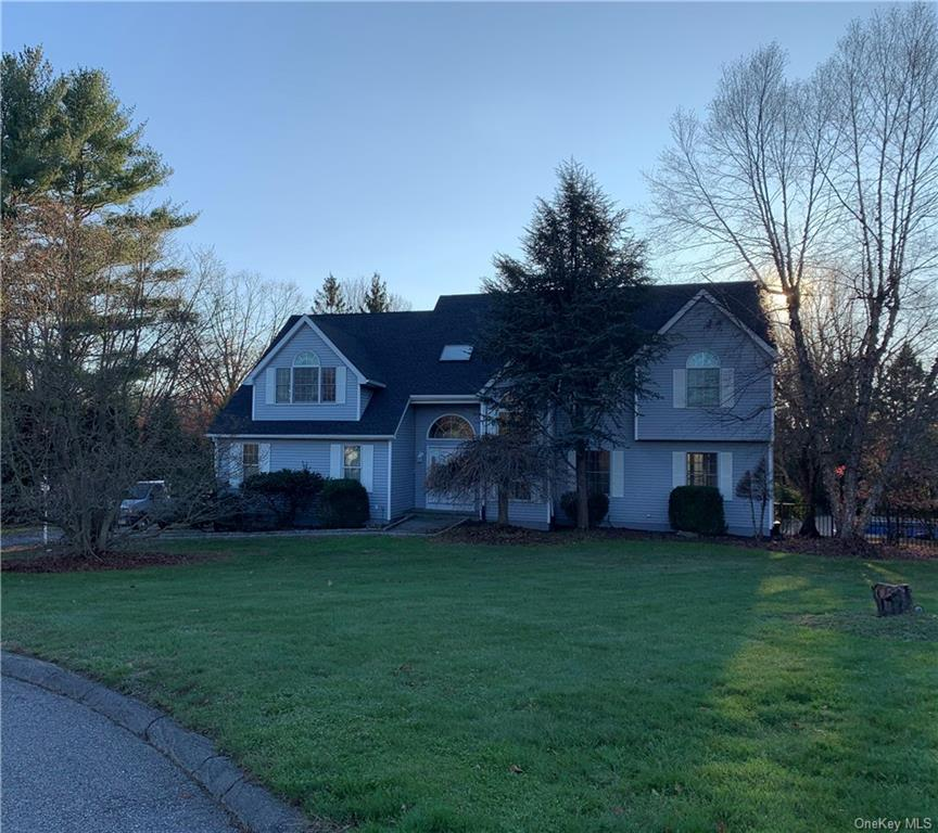 Gracious Colonial with an over sized yard and inground pool  on a private cul de sac! This executive