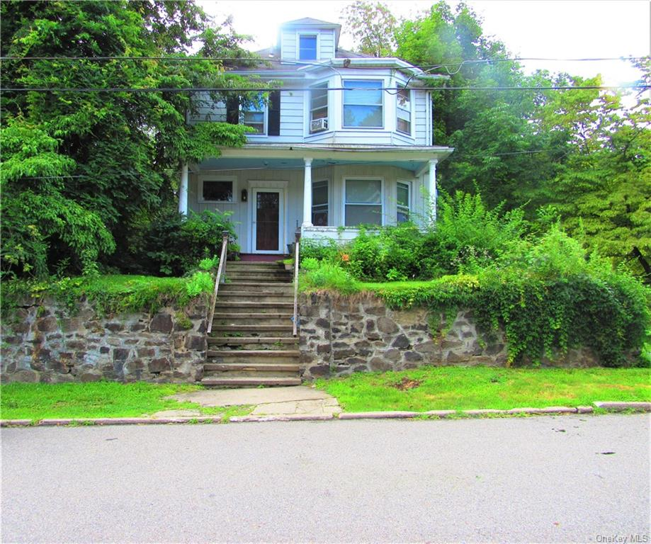 LOCATION LOCATION LOCATION! Spacious colonial nestled on a corner lot with the potential to bring ou