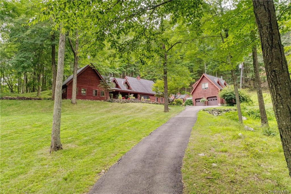 Privacy and tranquility just an hour from NYC. A winding driveway takes you past rock outcroppings a