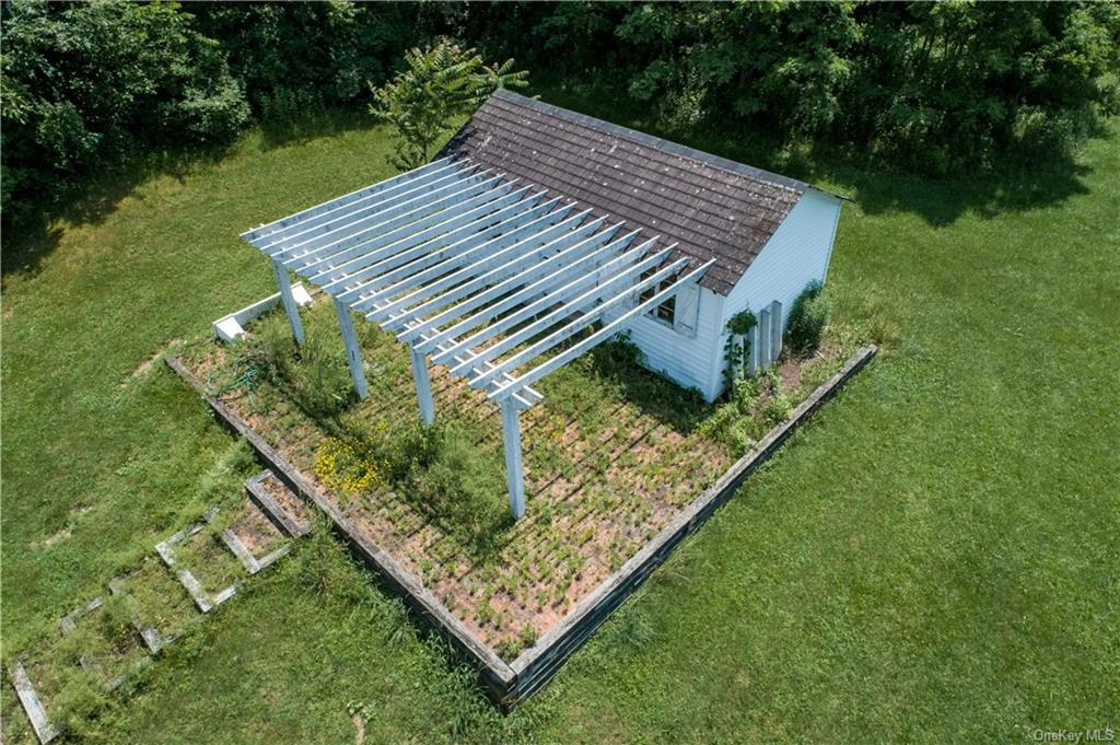 Sign for the Stone Hill Equestrian Facility in front of the first of five paddocks. Traver Road is on the right.