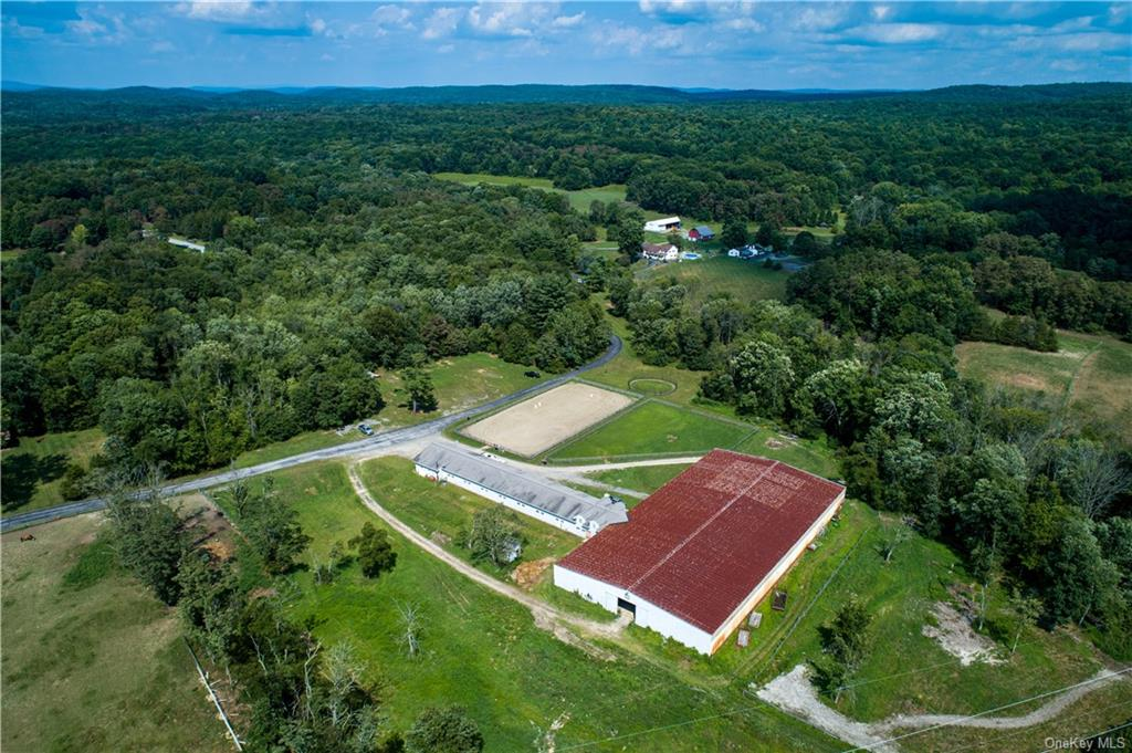 The barn, riding arena, and two of the five paddocks