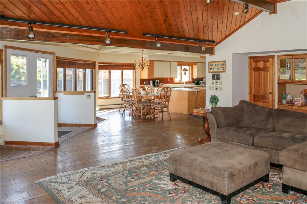 Vaulted wood ceiling and an open floorplan between the Great Room, Dining Room and Kitchen